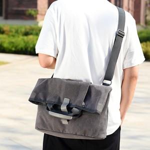 新款男士单肩斜挎包帆布大容量13寸电脑手提包休闲商务两用大号包