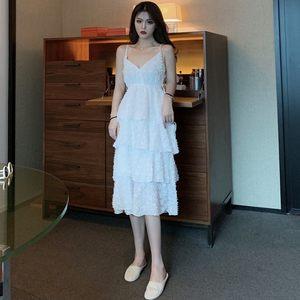 2019夏季新款高腰<span class=H>吊带</span>裙子气质V领流苏层层蛋糕中长款连衣裙女装