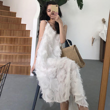 Korean version of Hong Kong Chic fashion feather fringed V-collar mid-long skirt irregular hem sling skirt dress summer
