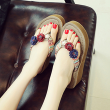 Slippers Female Outside the Summer Wears the New Fashion Seaside Beach Shoes of 2019 with Thick Bottom, Slope heel and Sandwich Flower Flip-flops