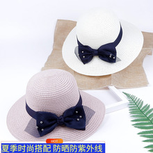 Elegant bow tie on straw hat beach with sun hat and sunshade hat eaves