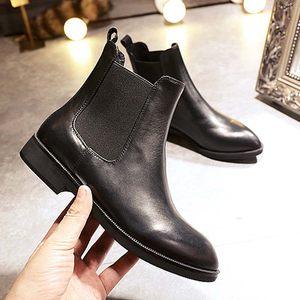 秋冬真皮短靴平跟尖头英伦风平底马丁靴裸靴短筒牛皮女靴切尔西靴
