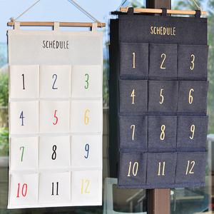 星期天月份布艺<span class=H>挂袋</span>收纳宿舍储物袋壁挂墙挂式多层挂墙置物袋包邮